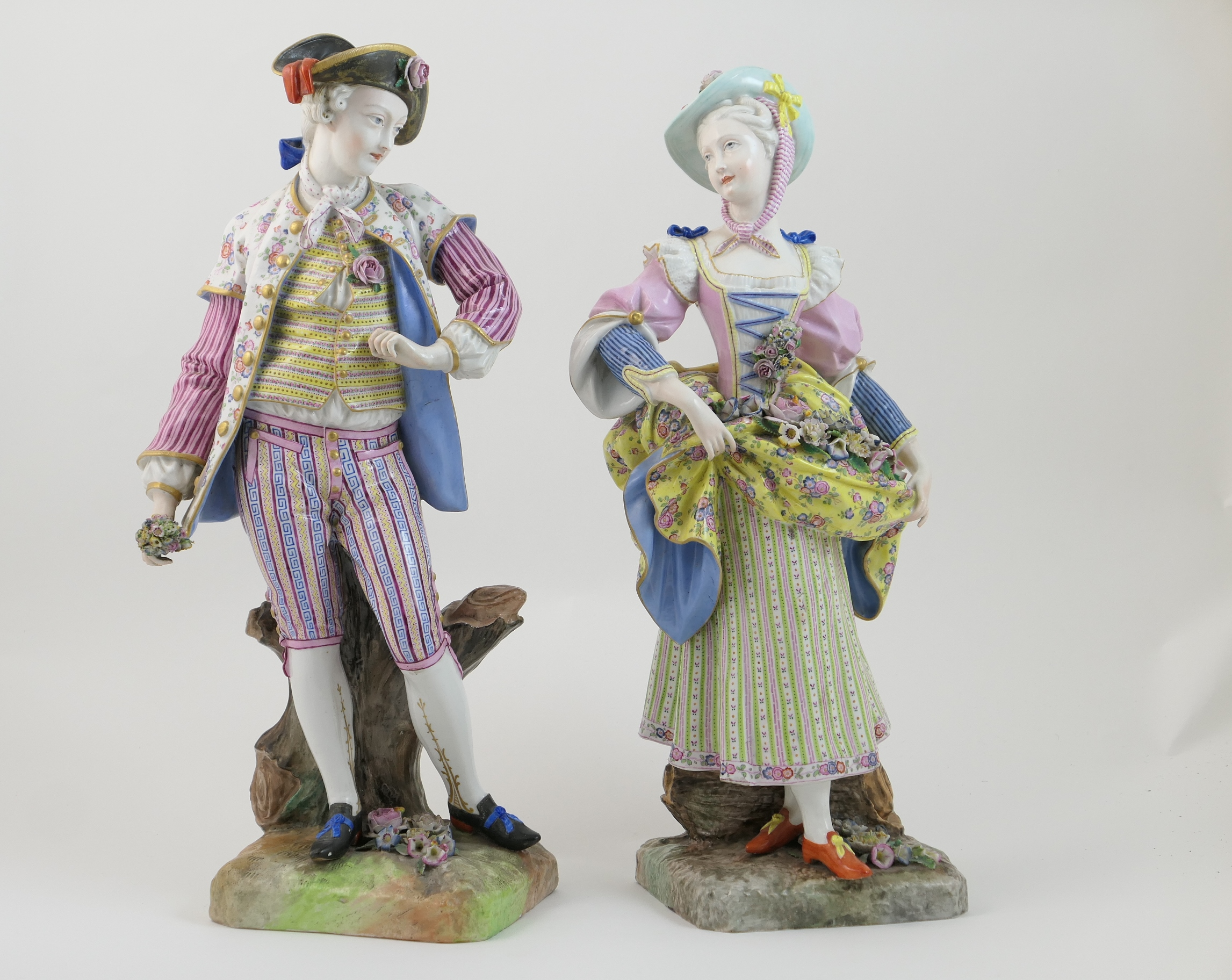 Lot 60 - Pair of Dresden porcelain figures of gardeners, after Meissen, circa 1870, each modelled in 18th
