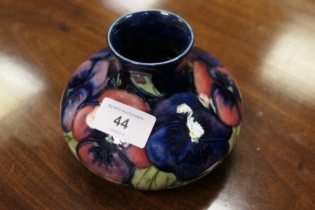 Lot 44 - Moorcroft Pansies short baluster vase, circa 1920-30, impressed mark and painted signature,