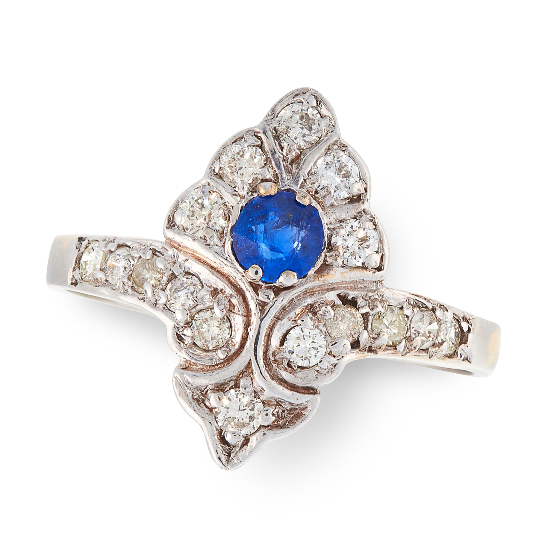 A SAPPHIRE AND DIAMOND DRESS RING the shield shaped face set with a round cut sapphire accented by