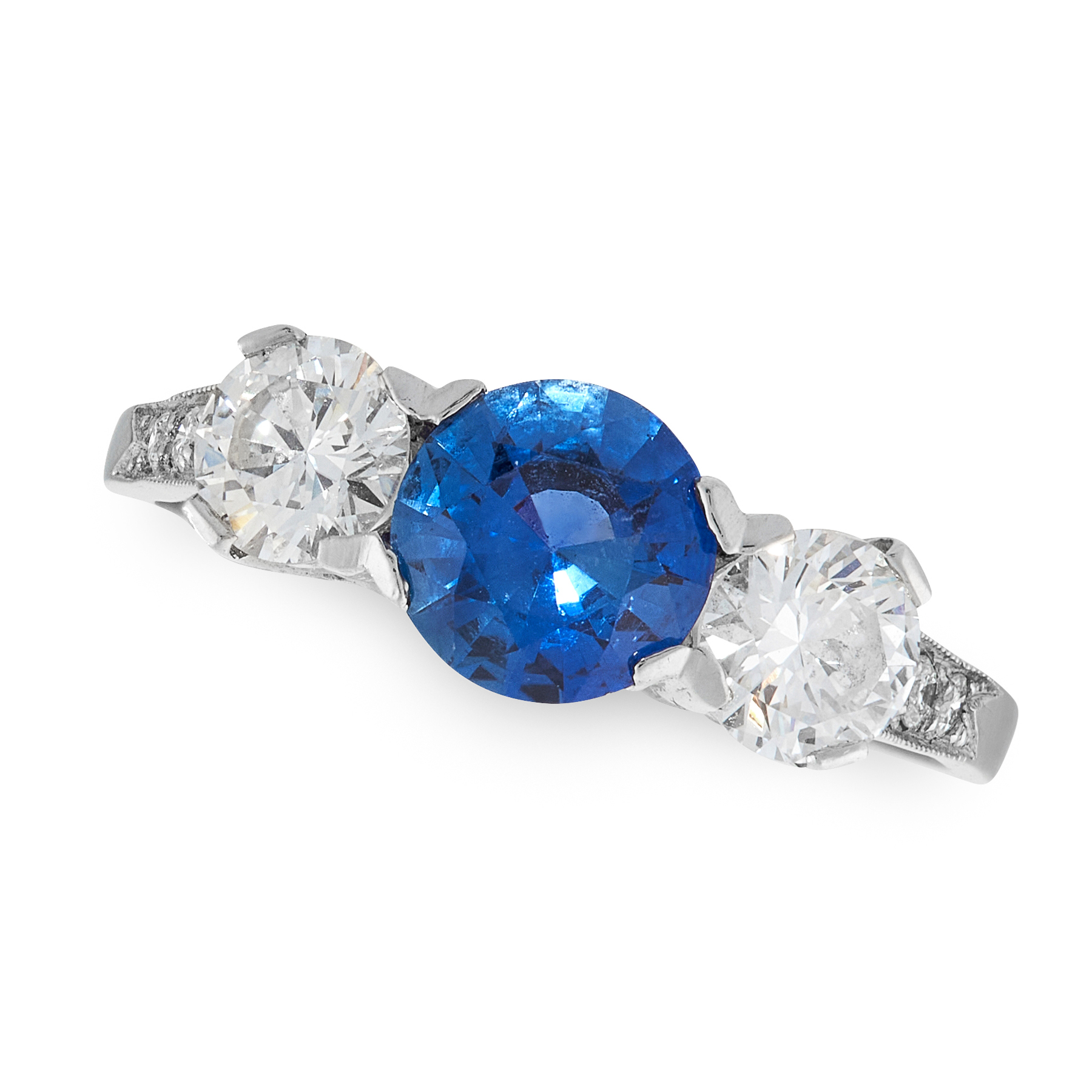 A SAPPHIRE AND DIAMOND THREE STONE RING in platinum, set with a round cut sapphire of 0.92 carats