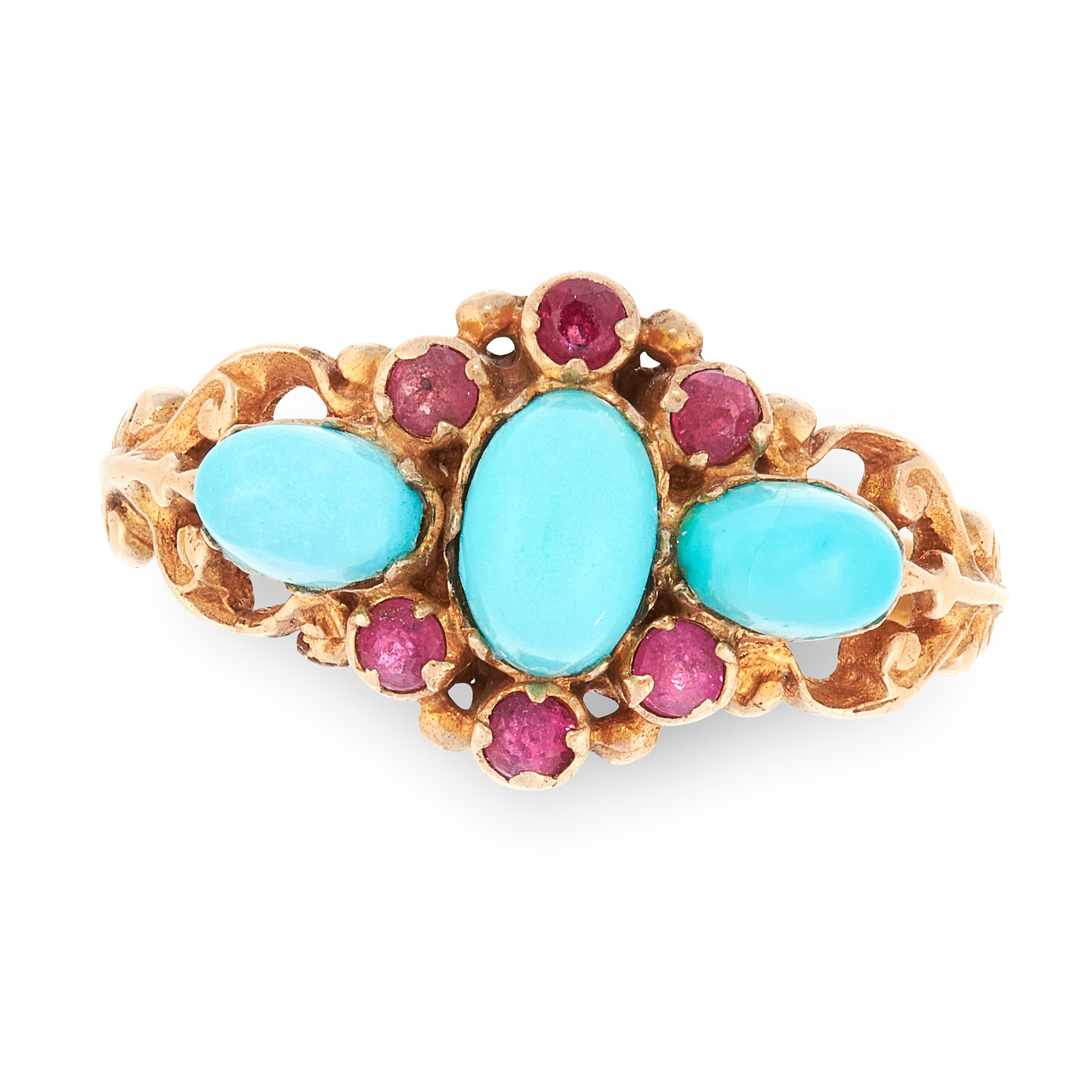 A TURQUOISE AND RUBY RING in yellow gold, set with a central cabochon turquoise in a border of round