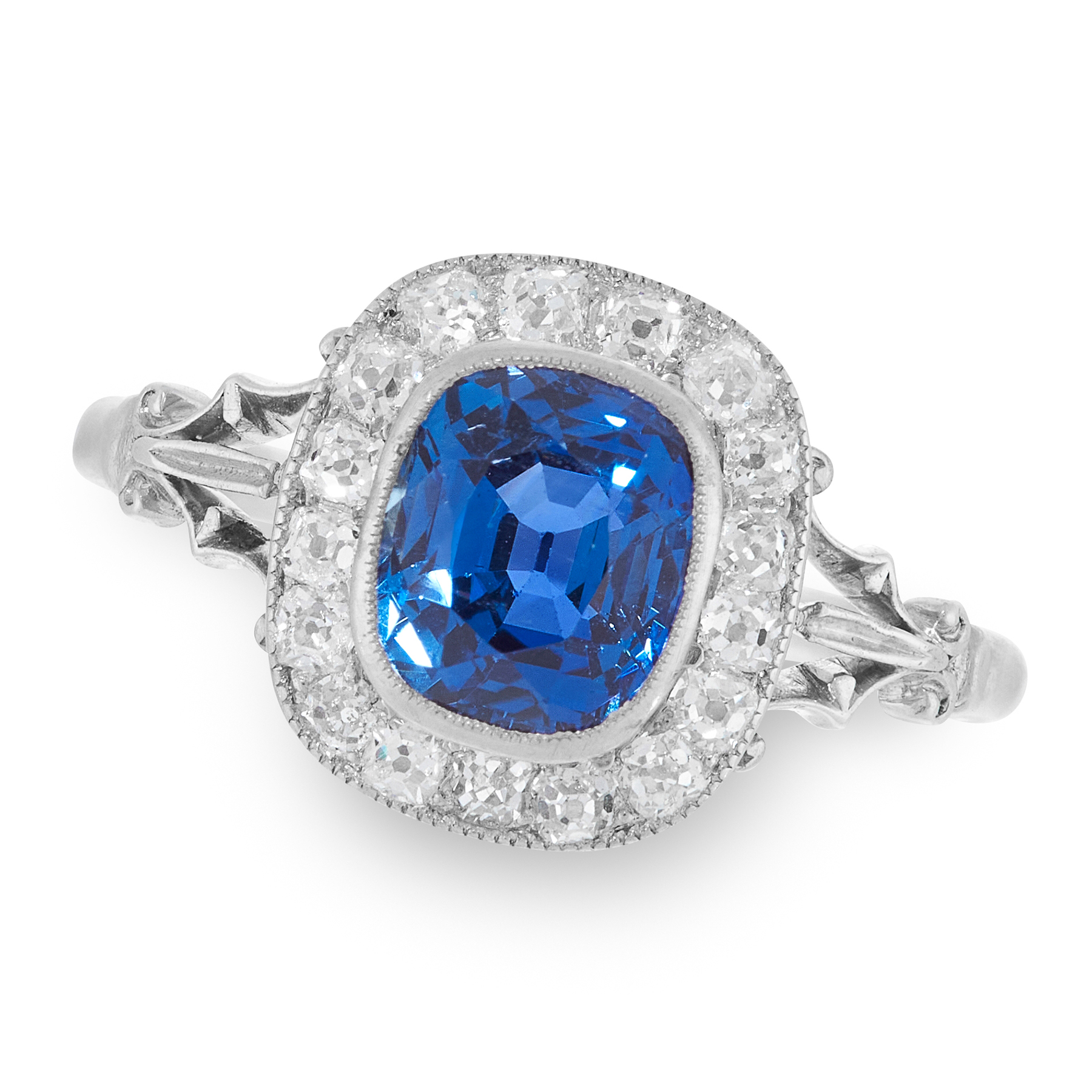 A CEYLON NO HEAT SAPPHIRE AND DIAMOND RING set with a cushion cut sapphire of 2.20 carats, within