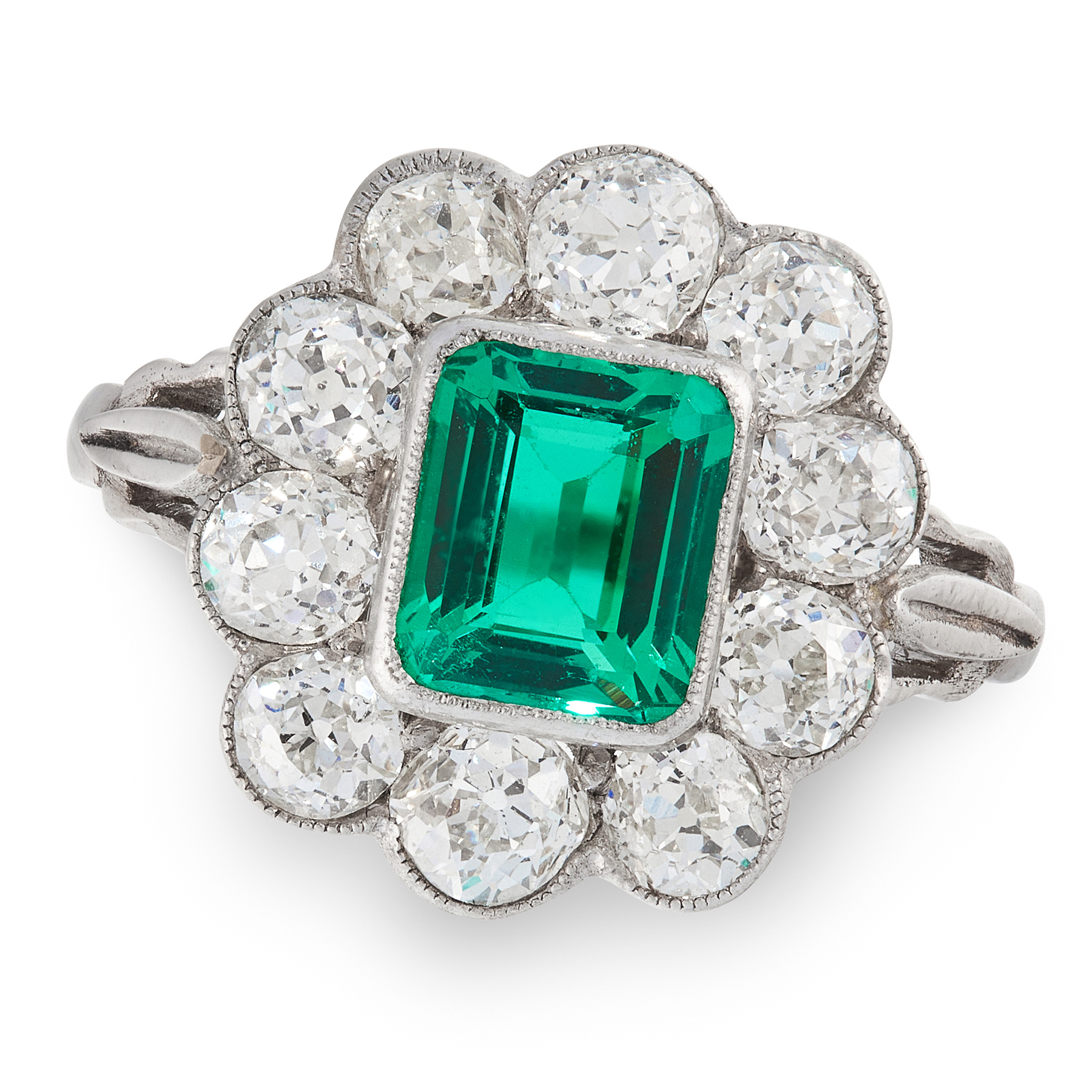 A COLOMBIAN EMERALD AND DIAMOND CLUSTER RING set with an octagonal cut emerald of 1.55 carats, in