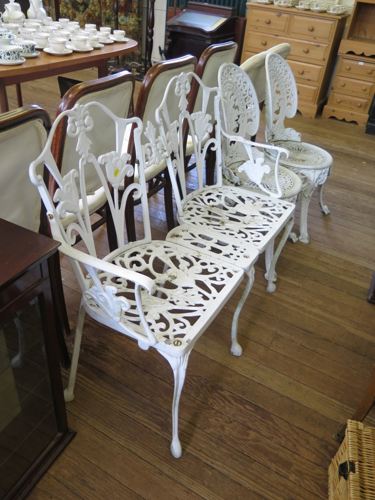 Lot 29 - A white painted metal two seat garden bench and two single chairs (3)
