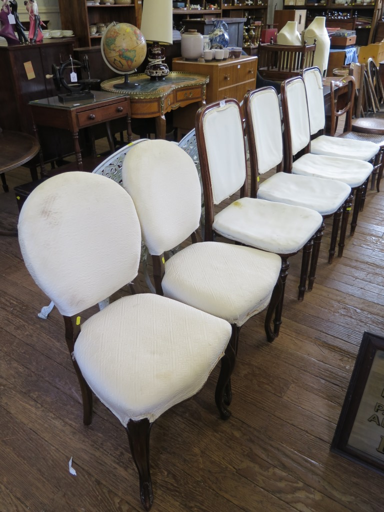 Lot 10 - A set of four French late 19th century occasional chairs, the upholstered backs and seats on