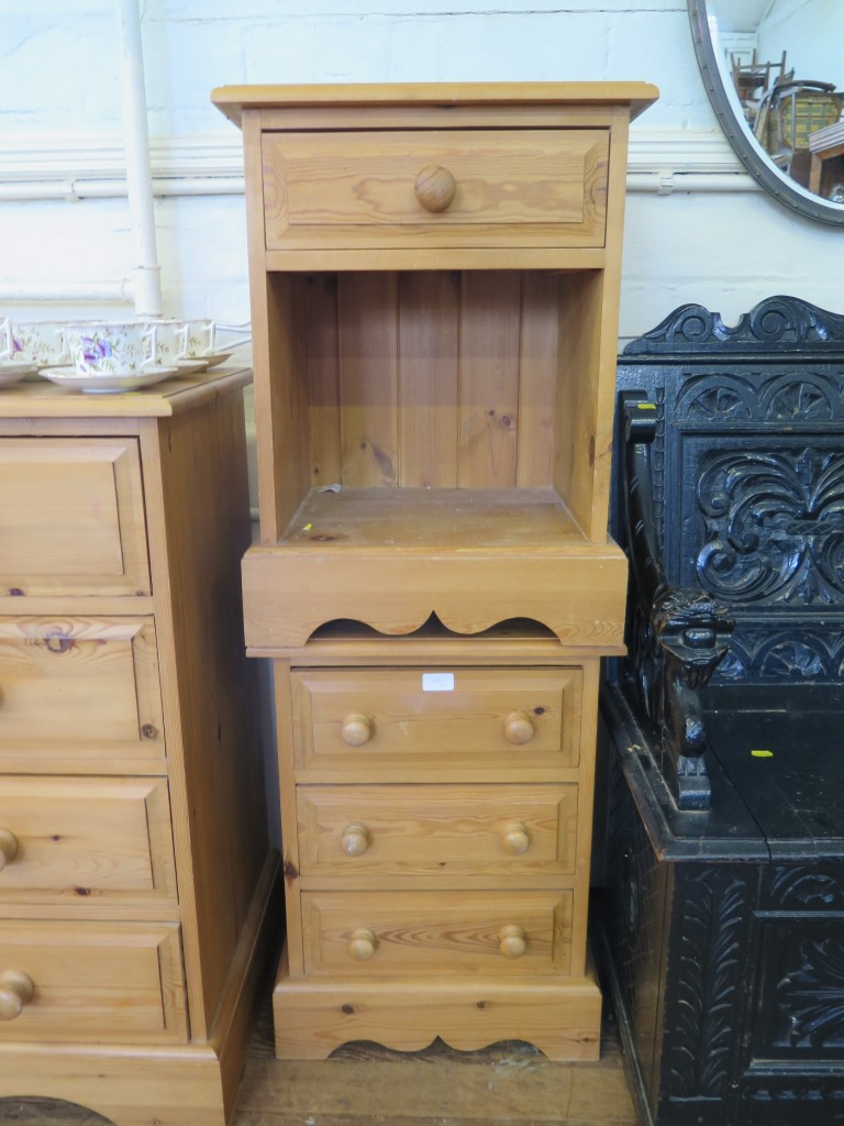 Lot 39 - A pine chest of two short and three long drawers on bracket feet, 91.5cm wide and two pine bedside