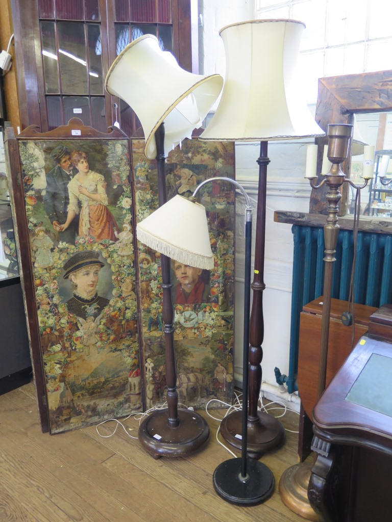 Lot 51 - A 1940s chrome and black metal standard lamp and two turned wood standard lamps (3)