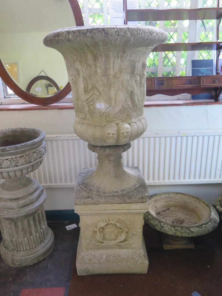 Lot 2 - A large Classical style campana shape garden urn, with wreath design plinth 139cm high