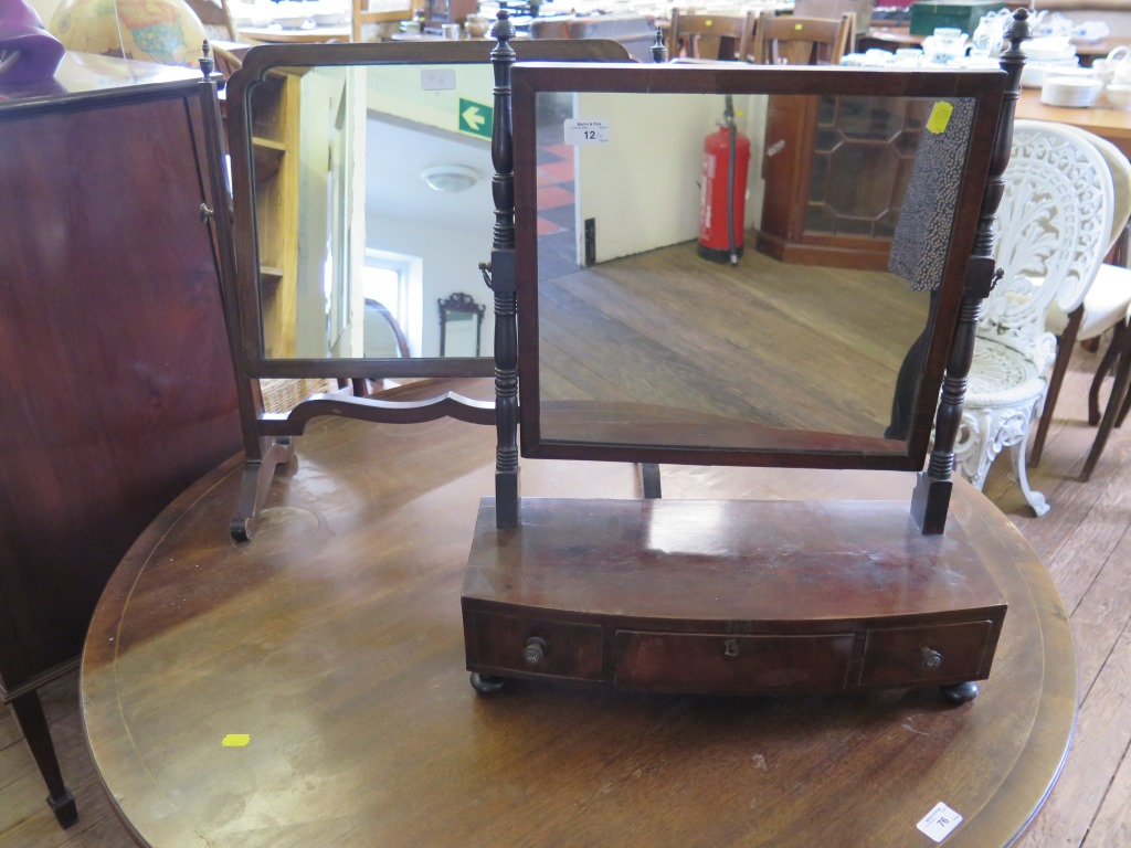 Lot 12 - A 19th century mahogany toilet mirror, with turned supports on a bowfront base with three drawers on