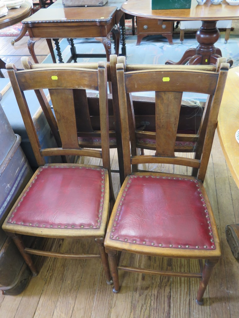 Lot 41 - A set of four beech dining chairs, with solid rails and splats, leatherette seats and turned legs