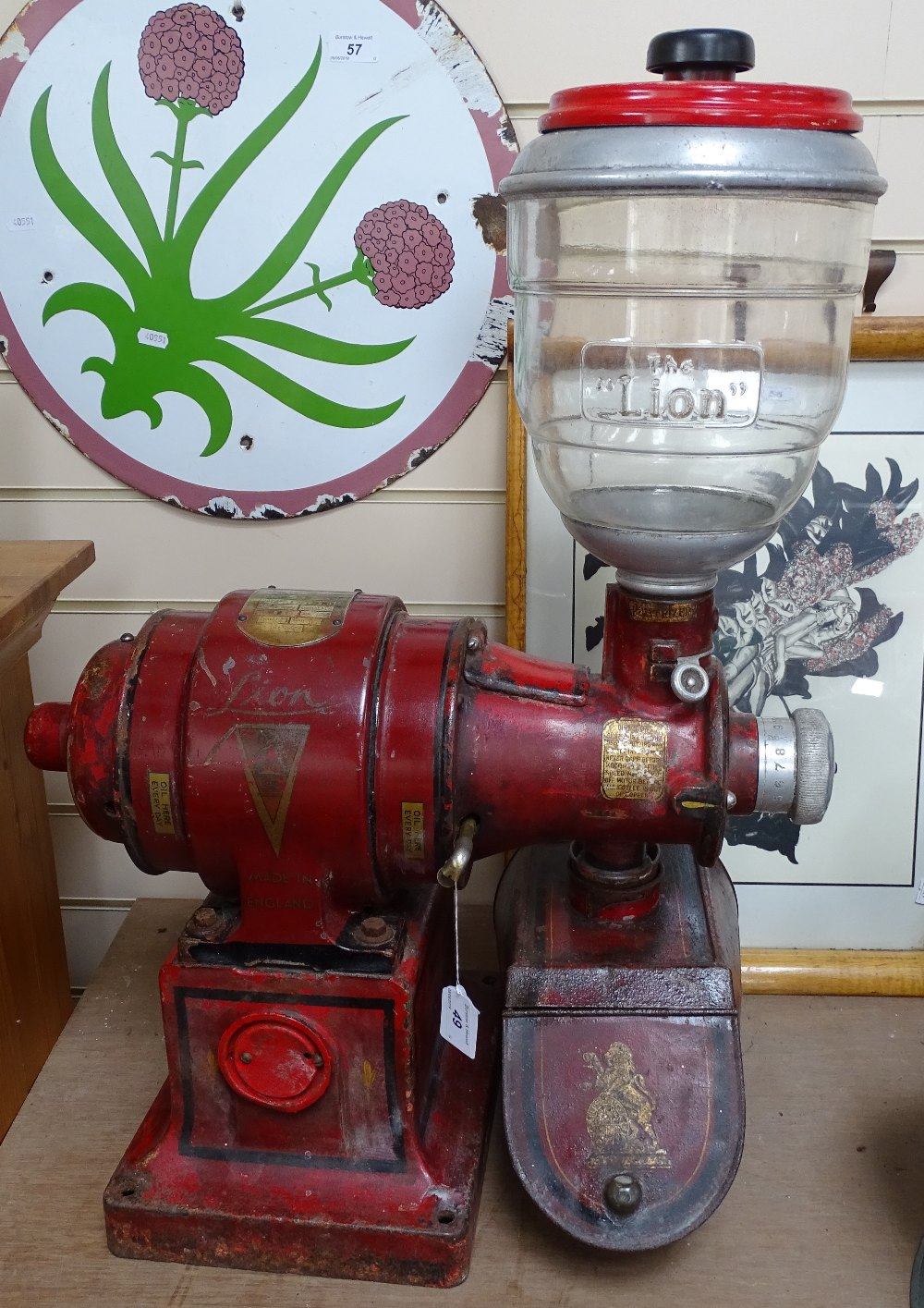 Lot 49 - An early 20th century Lion brand painted cast-iron coffee grinding machine, by Herbert & Sons