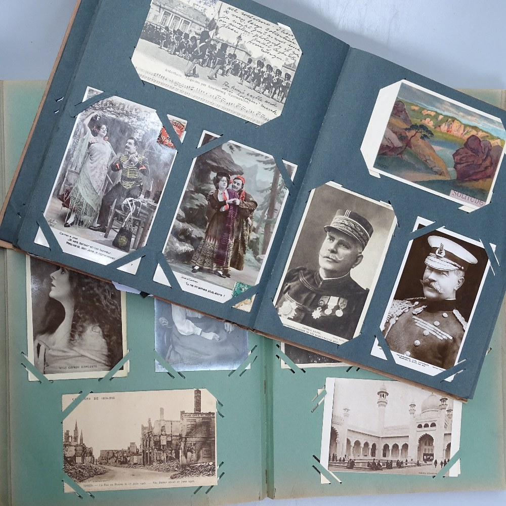 Lot 26 - 2 albums of early 20th century postcards, including First World War