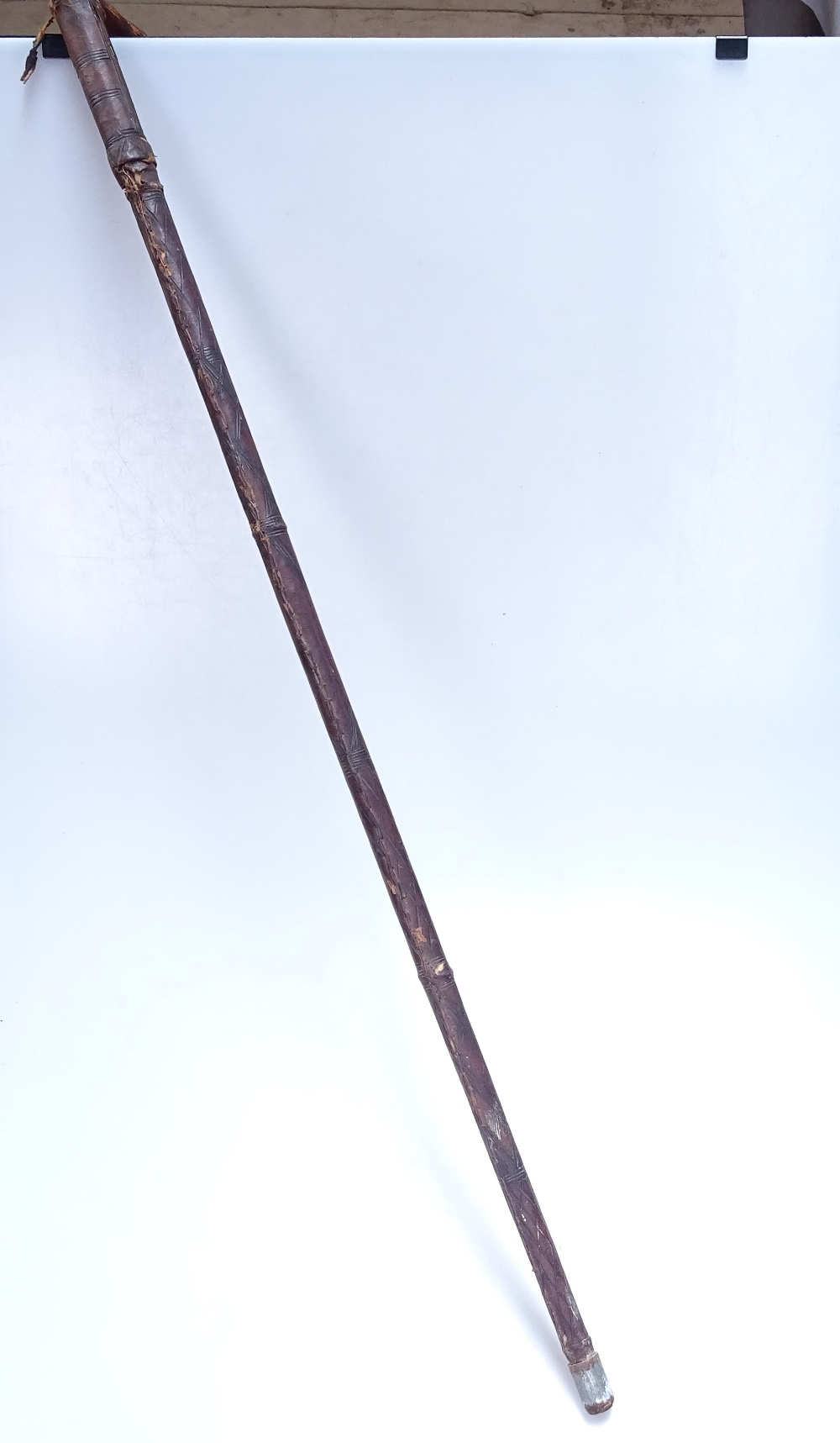 """Lot 22 - A leather-covered wooden Antique sword stick, 36"""""""