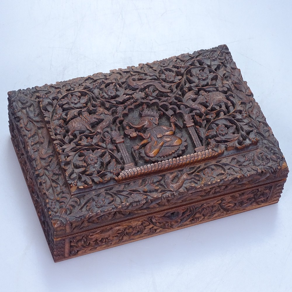 """Lot 16 - An intricately carved Indian box depicting Ganesh, length 9"""""""
