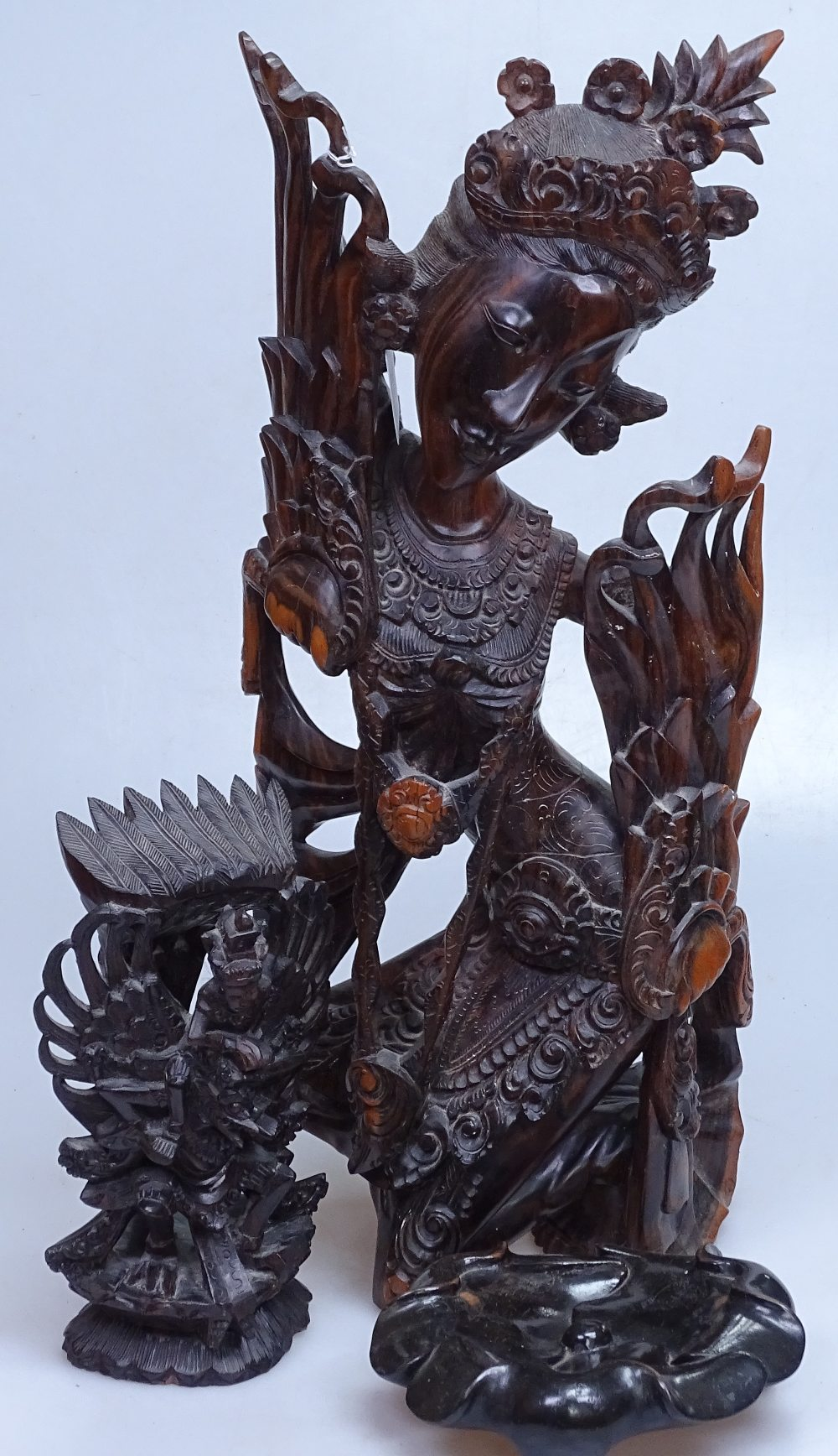 """Lot 59 - 2 Eastern carved wood figures, tallest 19"""", and an Oriental carved wood stand"""