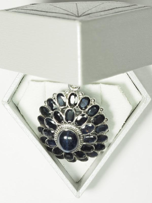 Lot 25 - Sterling Silver Large Star Sapphire (5.15ct) with 30 Sapphire (5.60ct) Floral Brooch Pendant. Retail