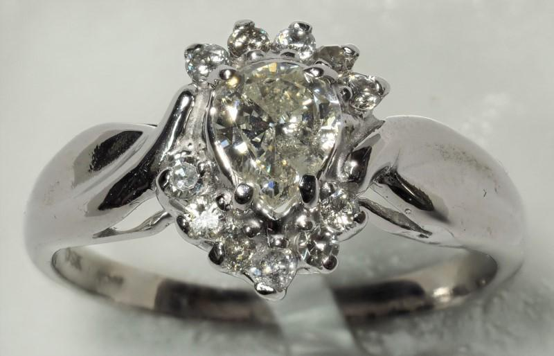 Lot 43 - 10K White Gold Pear Diamond (0.44ct, April Birthstone) with 11 Accompanying Diamonds (0.11ct) Ring.