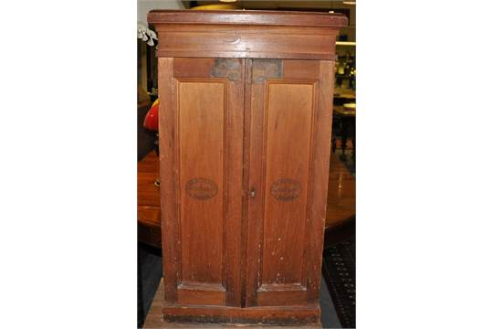 An early 20th Century Cuban two door cigar cabinet with internal hinged top  case, marked Partheas - An Early 20th Century Cuban Two Door Cigar Cabinet With Internal