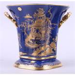 """A Carlton ware Blue Royale two-handled planter with gilt Oriental landscape, 8"""" high (foot rim"""