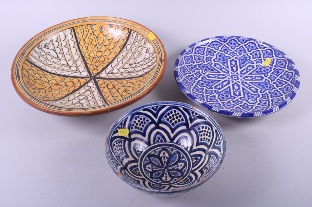"Lot 32 - A Moroccan shallow bowl with geometric design, 13"" dia (rim chips), a similar blue and white shallow"