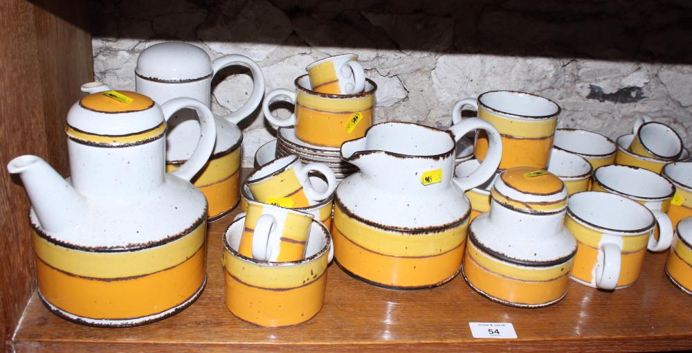 "Lot 54 - A Midwinter Stonehenge ""Sun"" pattern tea service, including two teapots, a milk jug, sugar ("