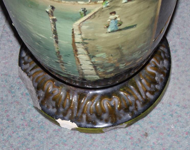 "Lot 28 - A Bretby Art Pottery landscape decorated vase, 38"" high (damages)"