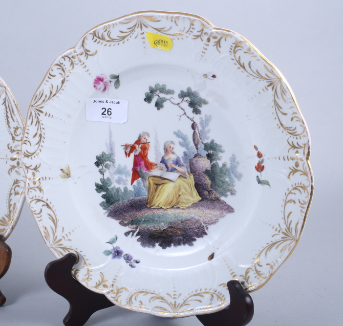 """Lot 27 - A set of three 19th century Meissen dessert plates with figure decoration and gilt borders, 10"""""""