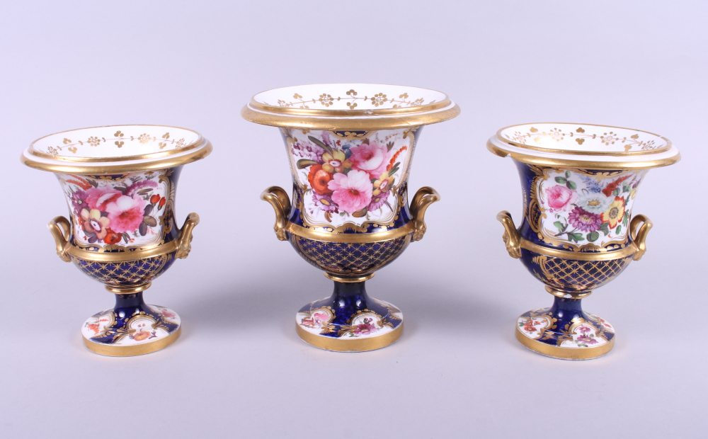 "Lot 22 - A garniture de chiminee with gilt and floral spray decoration, 6"" high"