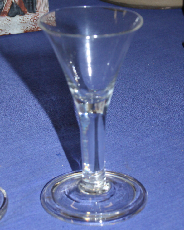 """Lot 51 - A conical wine glass with folded foot, 5"""" high, and a 19th century firing glass, 4 1/4"""" high"""