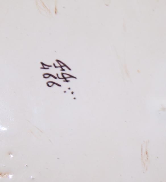 "Lot 21 - A Rouen faience fleur-de-lys wall pocket, 14"" high"