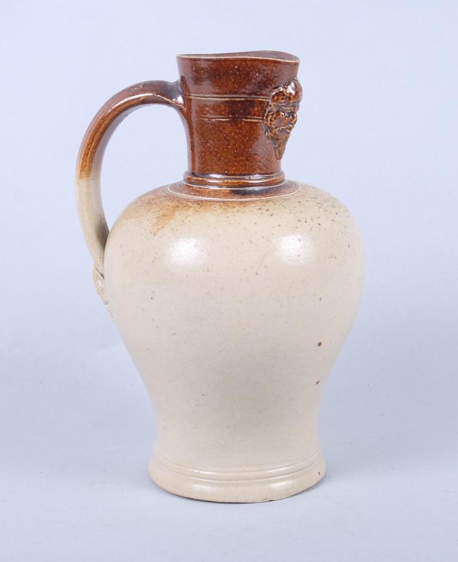 "Lot 8 - A Lambeth Stoneware jug with Silenus mask spout, 7"" high (small rim chip)"