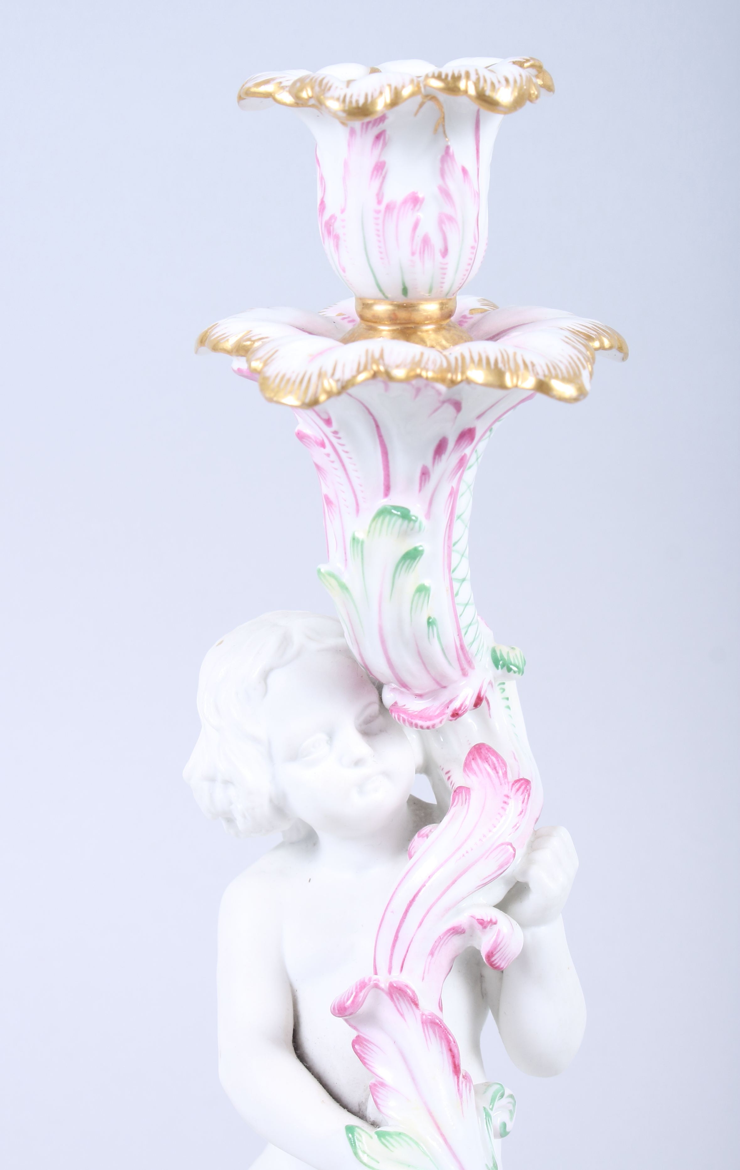 "Lot 6 - A 19th century Continental bisque porcelain candlestick with putto and scroll base, 10 3/4"" high"