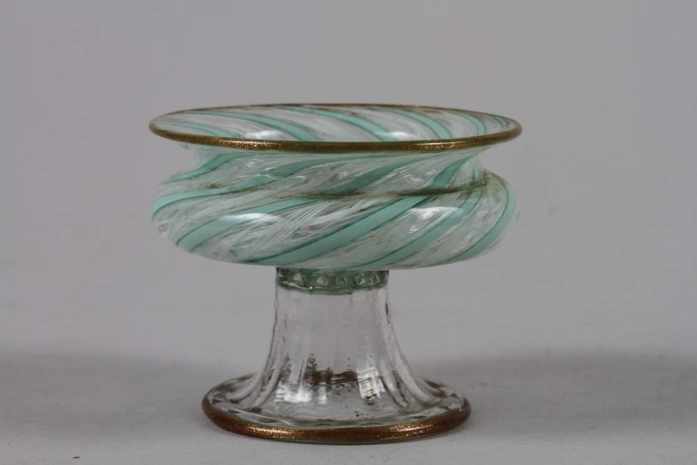 "Lot 39 - A Venetian green and white spiral glass salt with aventurine rim and folded foot, 2 1/2"" dia"