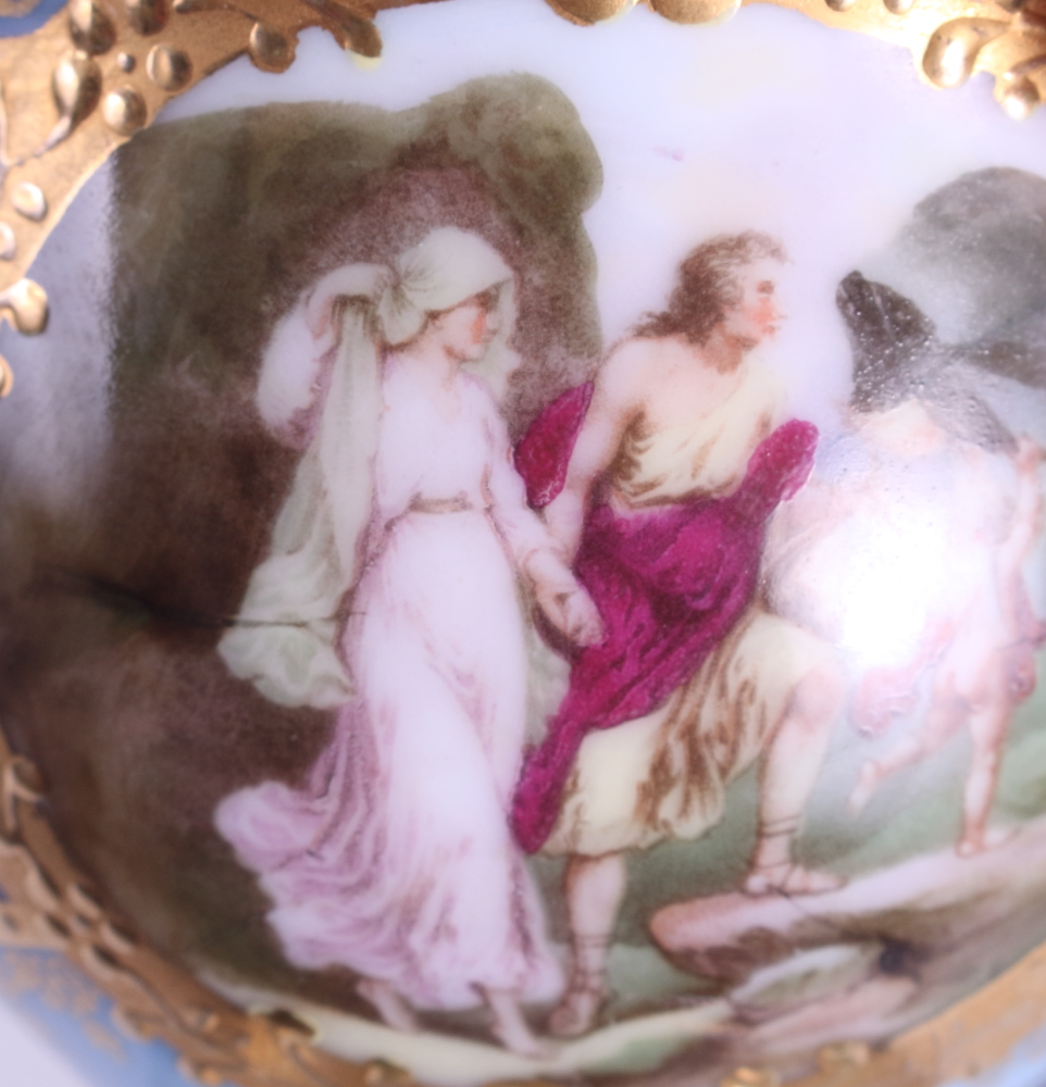 Lot 14 - A Vienna cabinet cup and saucer, decorated with floral and figure panels, on a blue ground with gilt
