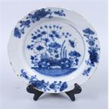 """An English delft blue and white plate, decorated with insects, root and plant, 10"""" dia (rim"""