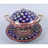 A 19th century Continental two-handled floral decorated bowl, cover and stand