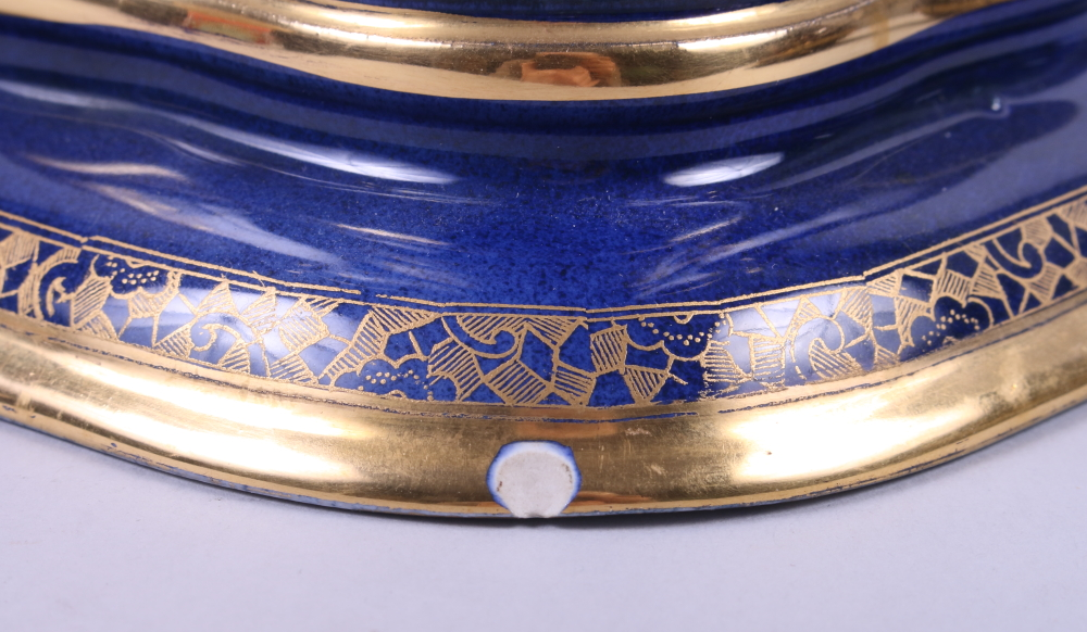 """Lot 13 - A Carlton ware Blue Royale two-handled planter with gilt Oriental landscape, 8"""" high (foot rim"""