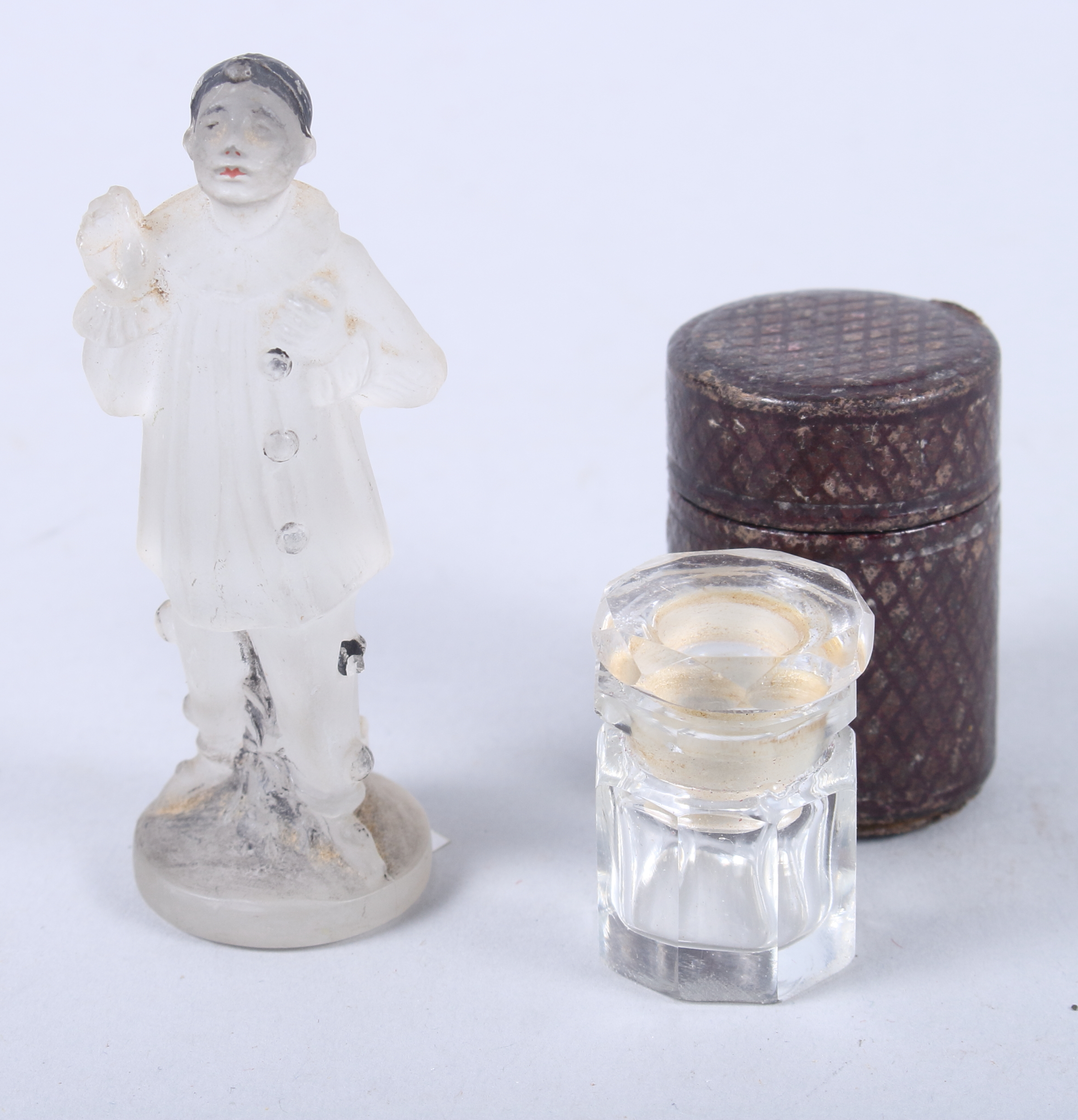 "Lot 35 - An Art Deco pressed glass figure of a Pierrot, 3"" high, and a 19th century cut glass vinaigrette /"