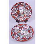 """A pair of early 19th century chinoiserie enamel decorated plates, 9 3/4"""" dia (one small rim chip)"""