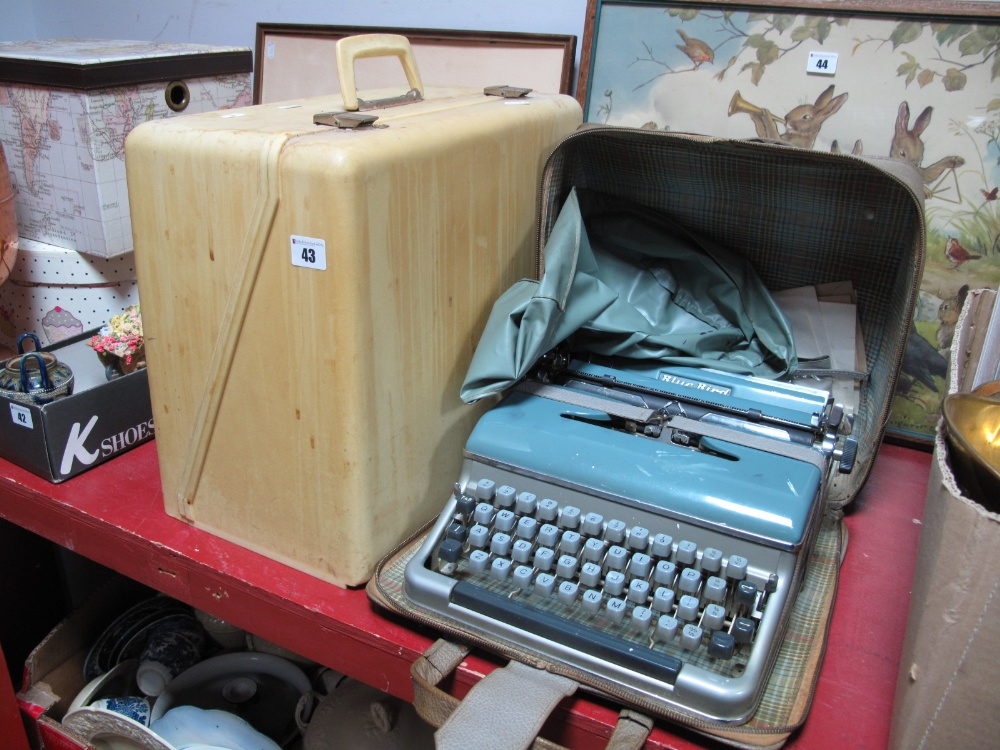 Lot 43 - A Portable Bluebird Typewriter, together with a New-Home electric sewing machine. (2)