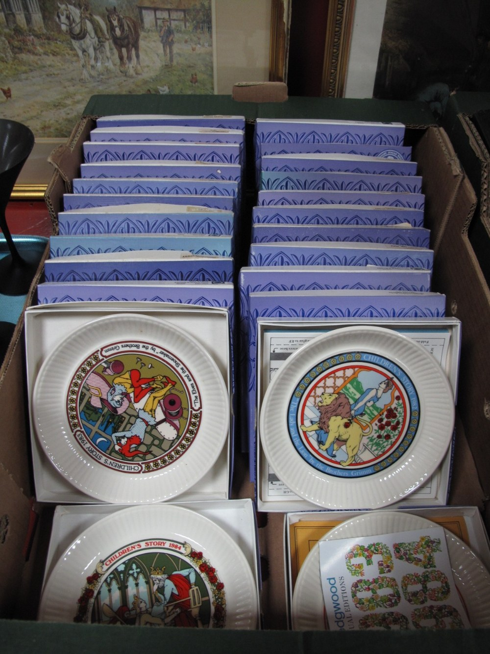 """Lot 10 - A Collection of Wedgwood """"Children's Stories"""" Year Plates, (twenty four plates):- One Box"""