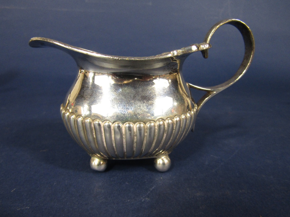 Lot 215 - Early 20th century Georgian style boat shaped half fluted tea service comprising teapot, milk jug