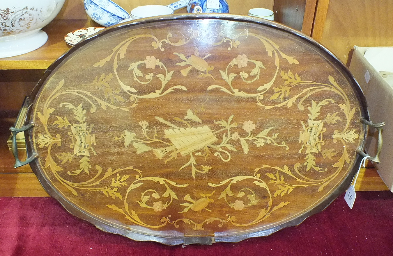 Lot 105 - An Edwardian mahogany gallery tray inlaid with boxwood foliage and musical motifs, 67 x 44cm, (a/