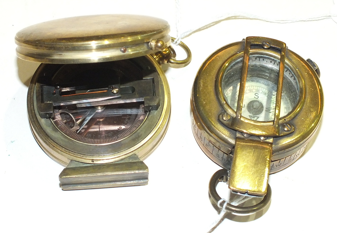 Lot 112 - A brass prismatic compass dated 1938, a reproduction range finder, various metalware and