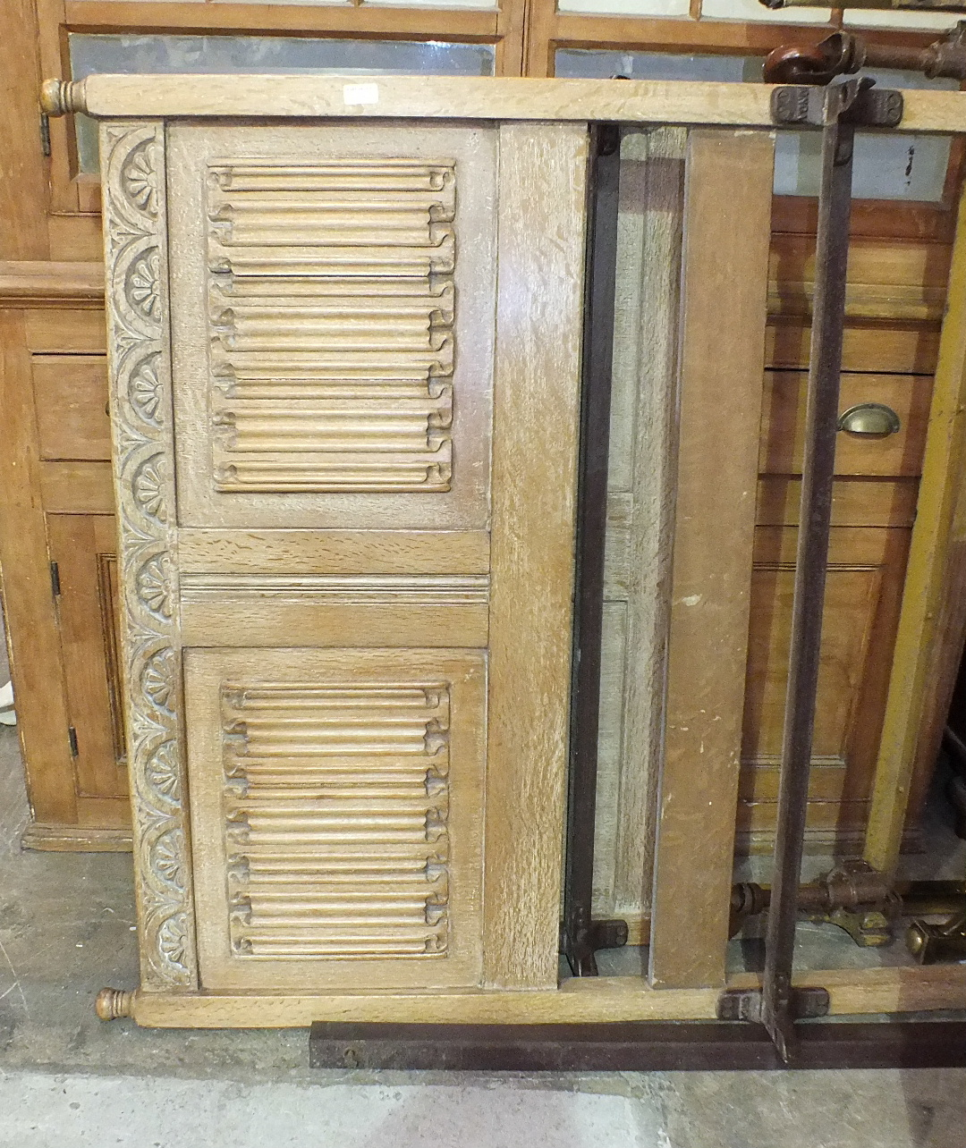 Lot 21 - A 20th century limed oak bedroom suite, comprising: a two-door wardrobe, dressing chest, tallboy,