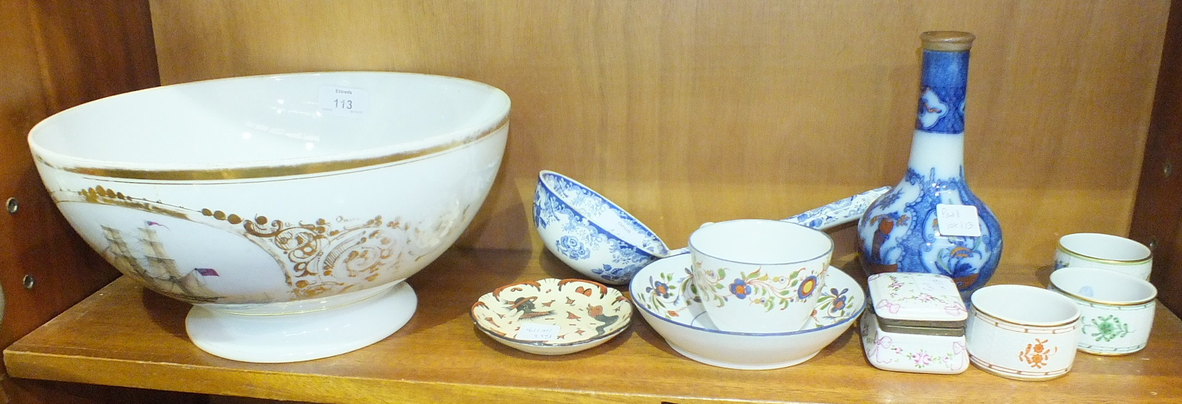 Lot 113 - An English blue and white pattern soup ladle, a Continental ceramic trinket box and cover, 7cm wide,