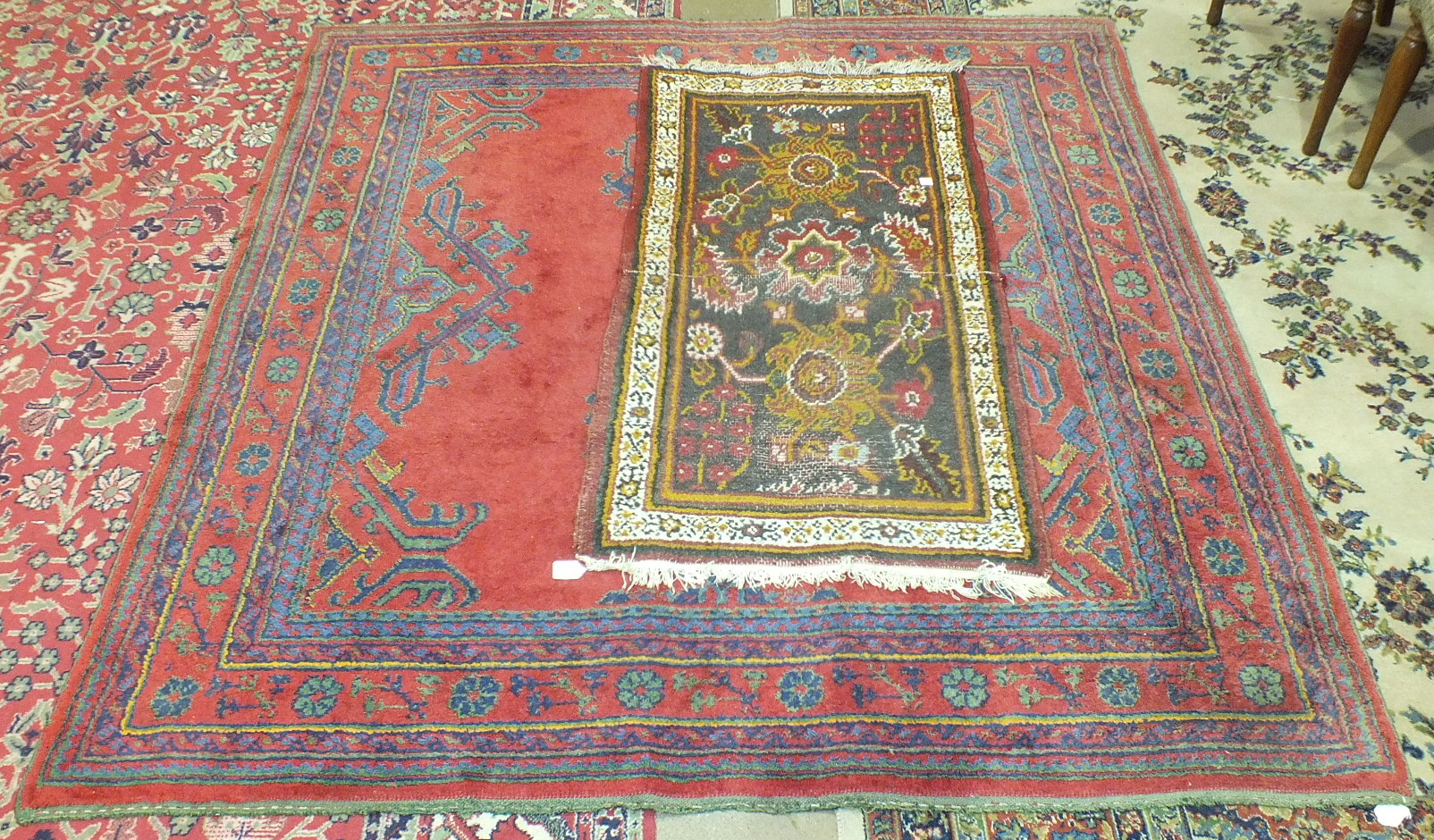 Lot 44 - A Turkey rug, 180 x 195cm and one other rug, (2).