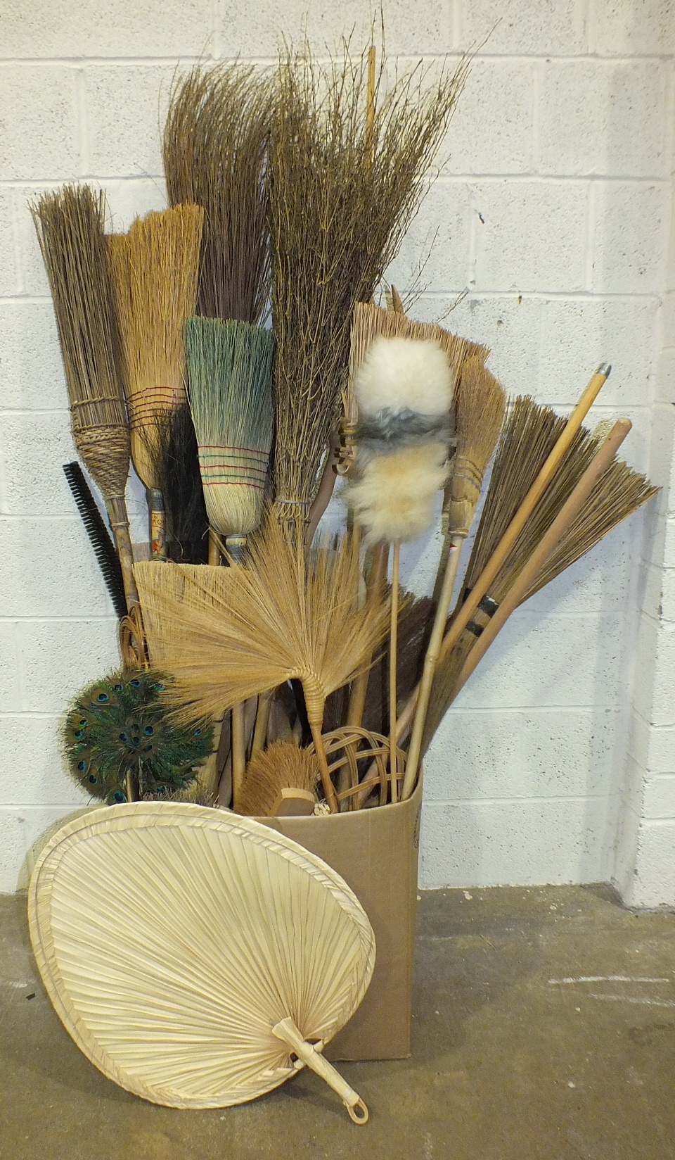 Lot 40 - A large and unusual collection of brushes made from natural materials, including besoms, hard