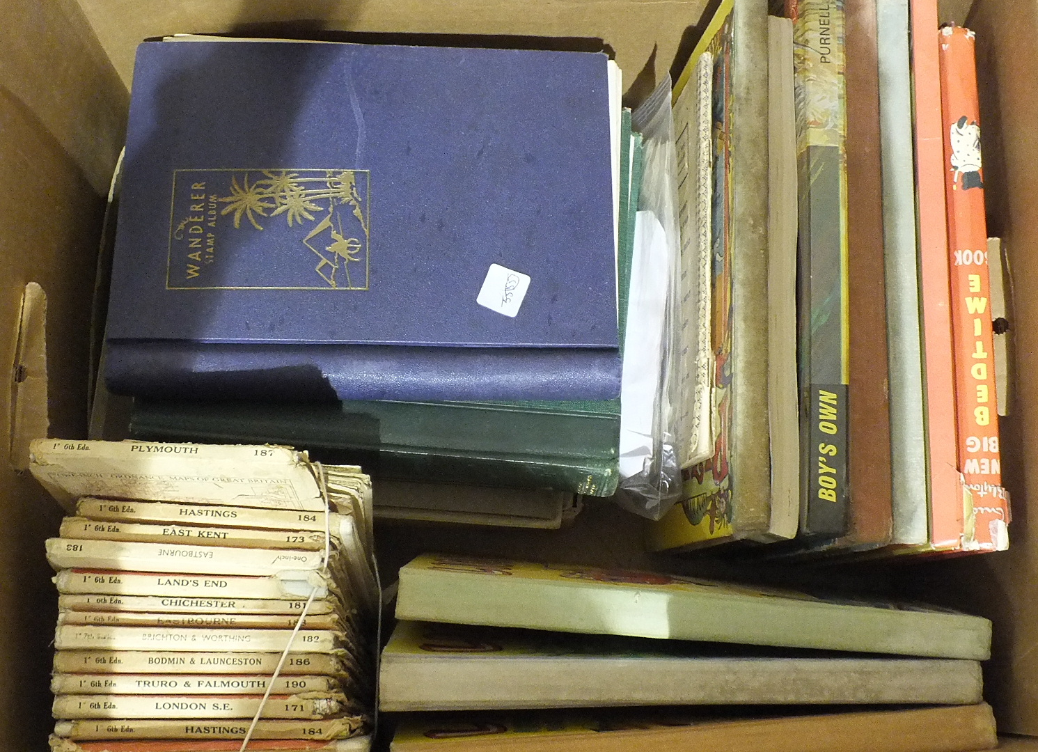 Lot 139 - A collection of British and world postage stamps in two albums, various cigarette and trade cards,