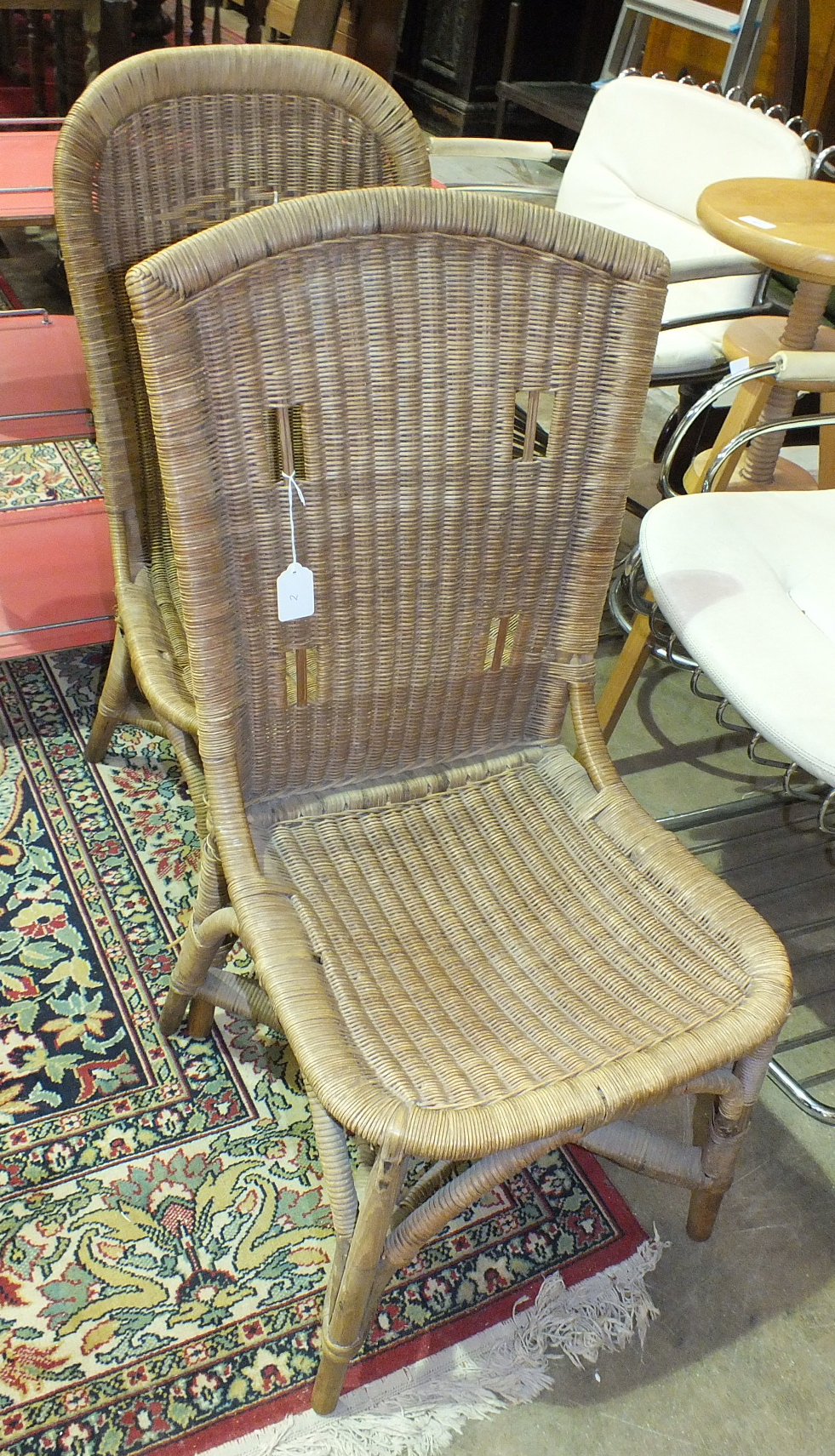 Lot 2 - A Maples & Co. wicker-work chair and a similar chair by Dryad, (2).